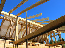 Installation of wooden beams at construction of frame house Stock Images
