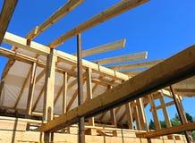 Installation of wooden beams at construction of frame house. Installation of wooden beams at construction of the frame house stock images