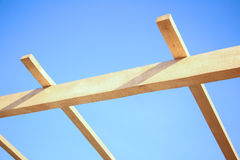 Installation of wooden beams at construction Stock Images