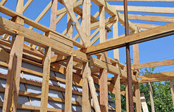 Installation of wooden beams at construction Royalty Free Stock Images