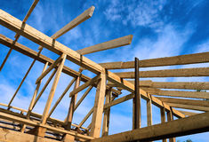 Installation of wooden beams at construction of the house Royalty Free Stock Photo
