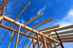 Installation of wooden beams at construction the roof truss syst Royalty Free Stock Photography