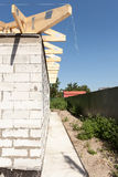 Installation of wooden beams, roof rafters at roof construction. New house made with autoclaved aerated concrete blocks. Installation of wooden beams, roof royalty free stock photos