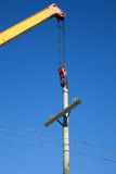 Installation of wooden electric poles crane Royalty Free Stock Photos