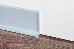 Installed skirting on the wall Royalty Free Stock Photo