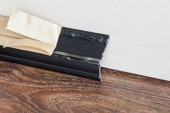 Installed skirting on the wall Royalty Free Stock Photos