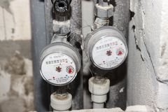 Installed water meters, hot and cold water meters on pipes, close-up. stock image