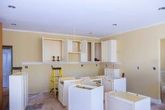 Installation of kitchen installs kitchen cabinet. Interior design construction kitchen. Installed wood kitchen cabinets with modern of installs cabinet stock photography