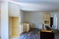 Installation of kitchen installs kitchen cabinet. Interior design construction kitchen. Installed wood kitchen cabinets with modern of installs cabinet stock photos