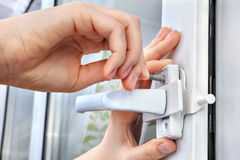 Installer installs  limiter for PVC window, he screwed screw, cl Stock Photo