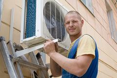 Installer sets a new air conditioner Stock Photos