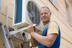 Installer sets a new air conditioner Stock Photos