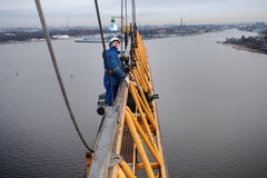 Installers working at high altitude, erecting tower crane liftin Stock Photography