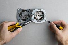 Installing AC power socket stock photos