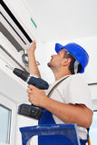 Installing air conditioning unit stock image