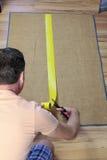 Installing Anti Slip Rug Tape Stock Image