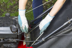 Installing catch bag on lawnmower Stock Image