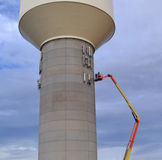 Installing cellular antennas on a water tower Royalty Free Stock Photo