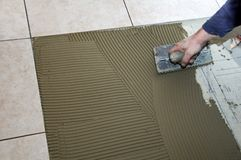 Installing Ceramic tile Stock Photos