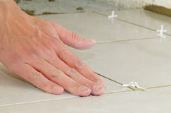 Installing ceramic tile flooring Royalty Free Stock Image