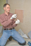 Installing ceramic tiles on a floor Stock Photos