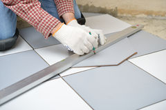 Installing ceramic tiles on a floor Royalty Free Stock Photography