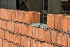 Installing clay block wall, lay clay block 2 Stock Images