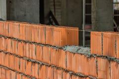 Installing clay block wall, lay clay block Royalty Free Stock Image