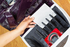 Installing Clean Air Filter in Vacuum Cleaner royalty free stock image