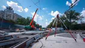 Installing concrete plates by crane at road construction site timelapse hyperlapse. stock video