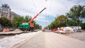 Installing concrete plates by crane at road construction site timelapse hyperlapse. stock video footage