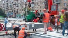 Installing concrete plates by crane at road construction site timelapse. stock video footage