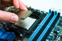 Installing the CPU into the motherboard Stock Photos