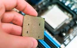 Installing the CPU into the motherboard Stock Photo