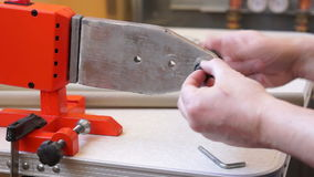 Installing die head on welding machine 01 stock video