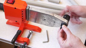 Installing die head on welding machine 02 stock video footage