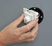 Installing a dimmer switch in a wall socket Royalty Free Stock Image
