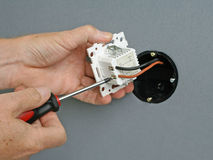 Installing a dimmer switch in a wall socket Royalty Free Stock Photos