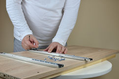 Free Installing Drawer Slides On A Cabinet Stock Image - 92991601