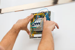 Installing Electric Fuse at Home Royalty Free Stock Images