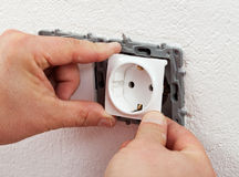 Installing electrical outlet or socket - closeup Royalty Free Stock Photo