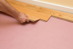 Installing Engineered Hardwood Floor. Series of shots of engineered hardwood floor being installed by a worker over pink felt paper using hand tools Stock Photos