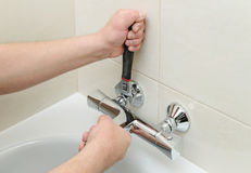 Installing faucet with thermostat. Royalty Free Stock Image
