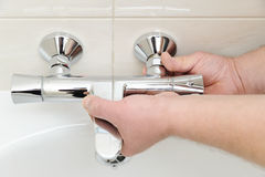 Installing faucet with thermostat. Royalty Free Stock Photos