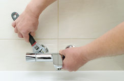 Installing faucet with thermostat. Royalty Free Stock Photo