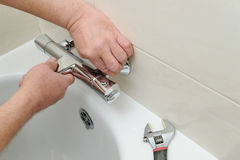Installing faucet with thermostat. Royalty Free Stock Images