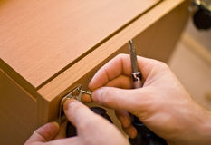 Installing the furniture Stock Photo