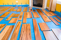 Installing hardwood floor. Preparation for installing planks of hardwood floor Stock Image