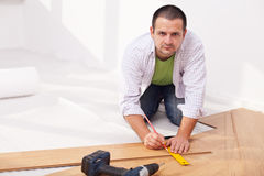 Installing laminate flooring Stock Photo