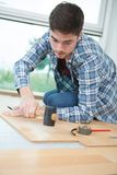 Installing laminate flooring fitting next piece. Installing laminate flooring fitting the next piece Stock Images